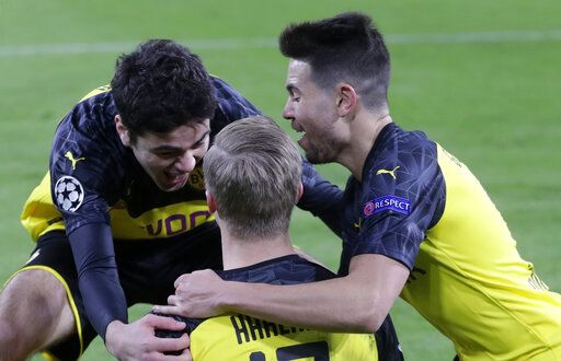 Dortmund's Erling Braut Haaland, center, celebrates with teammates after scoring his side's opening goal during the Champions League round of 16 first leg soccer match between Borussia Dortmund and Paris Saint Germain in Dortmund, Germany, Tuesday, Feb. 18, 2020.