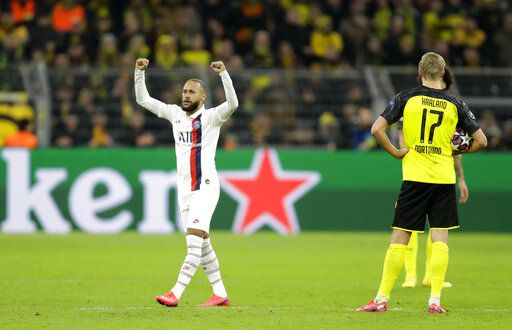 PSG's Neymar, left, celebrates after scoring his side's opening goal during the Champions League round of 16 first leg soccer match between Borussia Dortmund and Paris Saint Germain in Dortmund, Germany, Tuesday, Feb. 18, 2020.