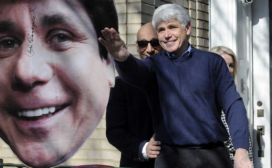 Former Gov. Rod Blagojevich waves to his friends after he gave a press conference at his Chicago home, one day after getting out of prison after having his sentence commuted by President Trump.