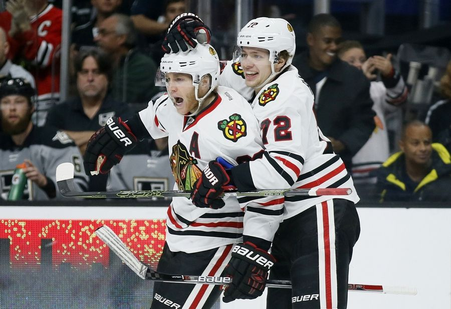 Patrick Kane and Artemi Panarin celebrate Kane's goal against Los Angeles in November 2016.