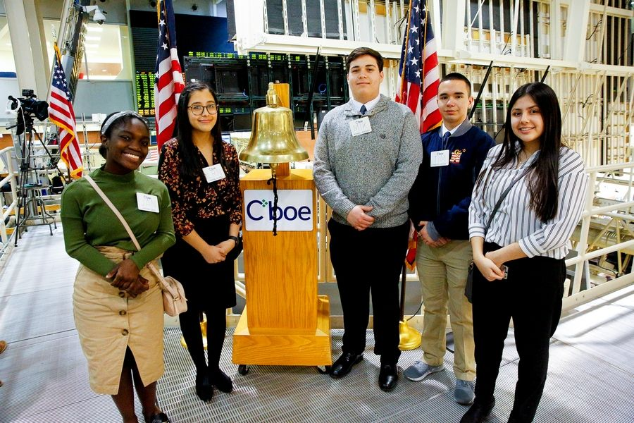East Aurora High School students, from left, Jenessa Davis, Lorena Alvarez, Michael Martinez, Tim Gehler and Jasmine Alcala pose in front of the iconic bell at the Chicago Board Options Exchange.