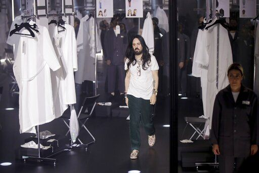 Designer Alessandro Michele walks out at the end of Gucci's Fall/Winter 2020/2021 collection, presented in Milan, Italy, Wednesday, Feb. 19, 2020.
