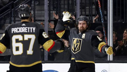 Vegas Golden Knights right wing Mark Stone, right, celebrates with left wing Max Pacioretty after scoring against the Tampa Bay Lightning during the second period of an NHL hockey game Thursday, Feb. 20, 2020, in Las Vegas.