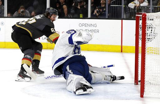 Vegas Golden Knights right wing Mark Stone (61) scores on Tampa Bay Lightning goalie Andrei Vasilevskiy during the second period of an NHL hockey game Thursday, Feb. 20, 2020, in Las Vegas.
