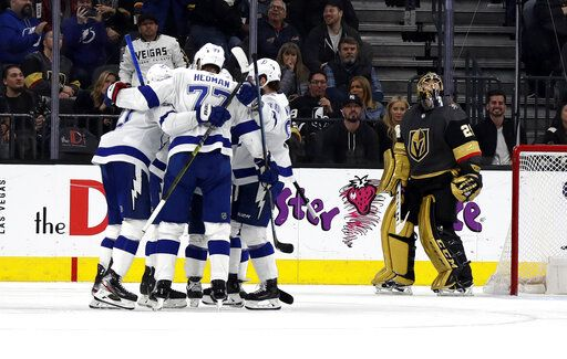 Tampa Bay Lightning players celebrate after forward Steven Stamkos, left, scored on Vegas Golden Knights goalie Marc-Andre Fleury (29) during the second period of an NHL hockey game Thursday, Feb. 20, 2020, in Las Vegas.