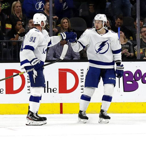 Tampa Bay Lightning forward Steven Stamkos (91) celebrates with forward Anthony Cirelli (71) after scoring during the second period of an NHL hockey game against the Vegas Golden Knights on Thursday, Feb. 20, 2020, in Las Vegas.