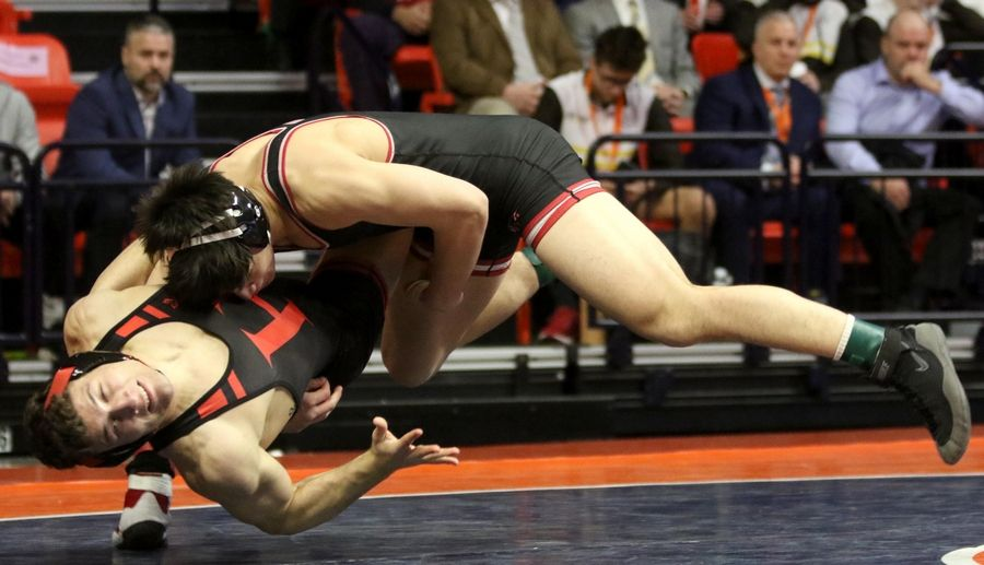 Huntley's David Ferrante, being thrown here, won against Barrington's Luke Rasmussen in the title bout at 170 pounds in Class 3A of the State Final Tournament in Individual Wrestling on Saturday at State Farm Center on the campus of the University of Illinois in Champaign.