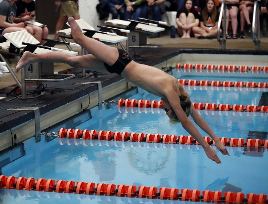 Leo Czerwinski of St. Charles East competes in the 200 freestyle athletes with disabilities race Saturday at the St. Charles East sectional.