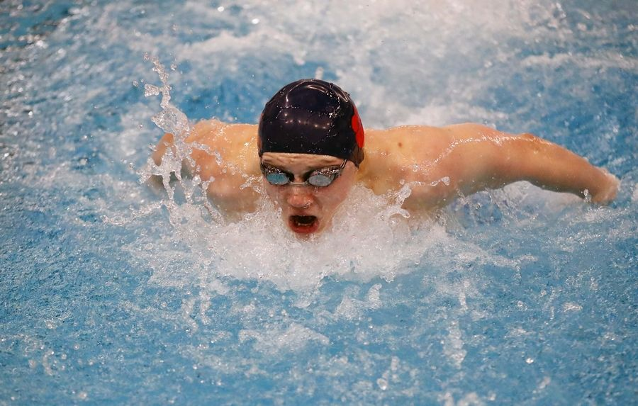Teegan Cook of the West Chicago Co-op competes in the Boys 100 yard Butterfly race Saturday February 22, 2020 during the IHSA Boys Swim and Dive Sectional Championship meet at St. Charles East High School.