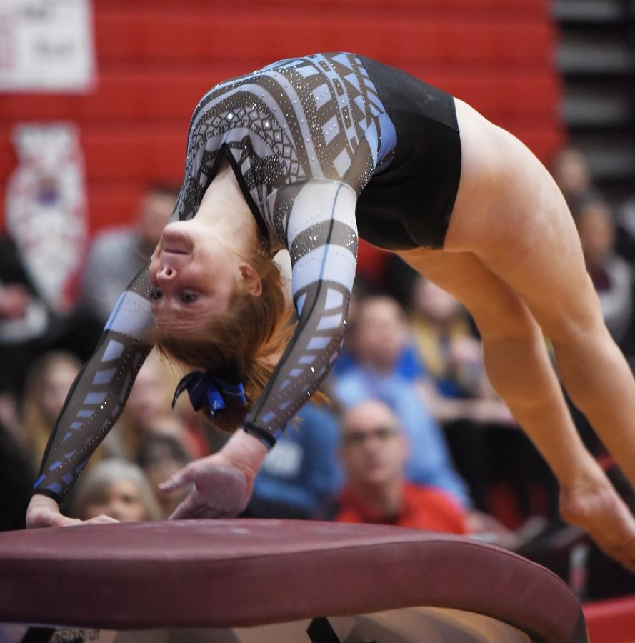 Lake Zurich's Kayla Bailey performs on vault at the state girls gymnastics championships at Palatine High School on Saturday.