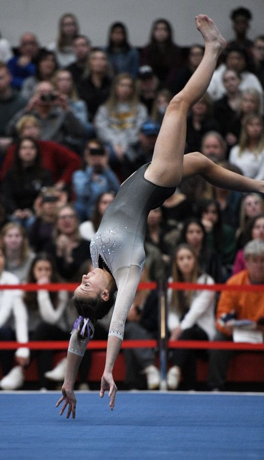 Carmel's Clare Keane performs on floor exercise at the state girls gymnastics championships at Palatine High School on Saturday.