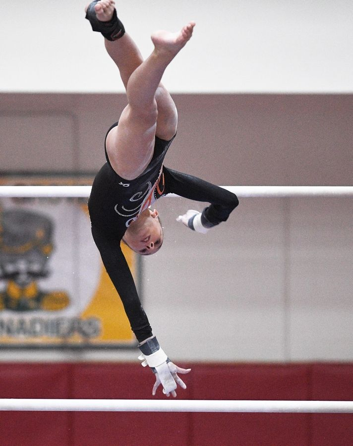 Libertyville's Anna Becker on uneven parallel bars at the state girls gymnastics championships at Palatine High School on Saturday.