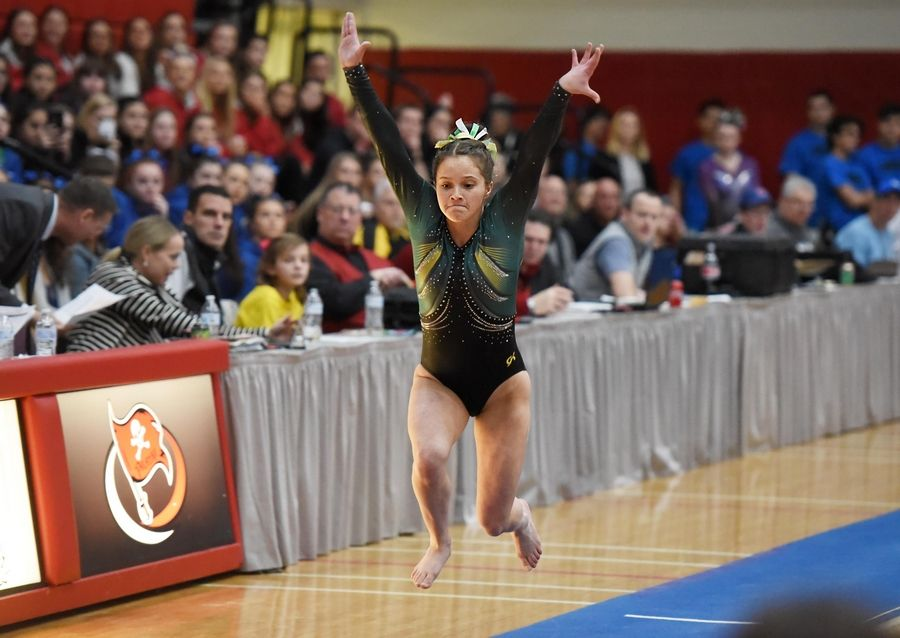 Stevenson's Emily Weinstein performs on vault at the state girls gymnastics championships at Palatine High School on Saturday.