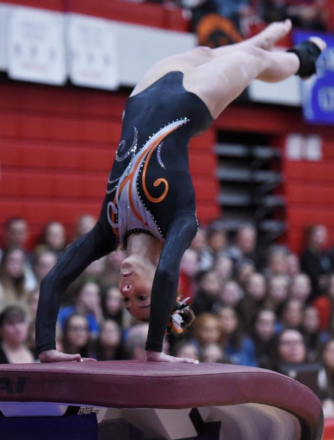 Libertyville's Anna Becker performs on vault at the state girls gymnastics championships at Palatine High School on Saturday.