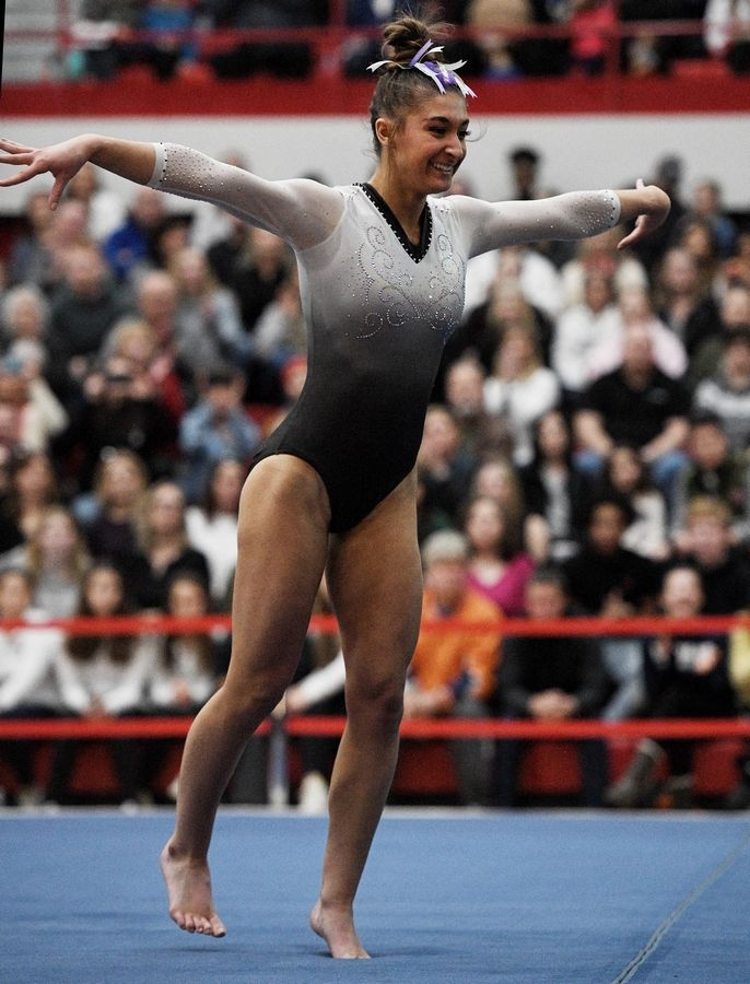 Carmel's Isabella Kropiwiec performs on floor exercise at the state girls gymnastics championships at Palatine High School on Saturday.