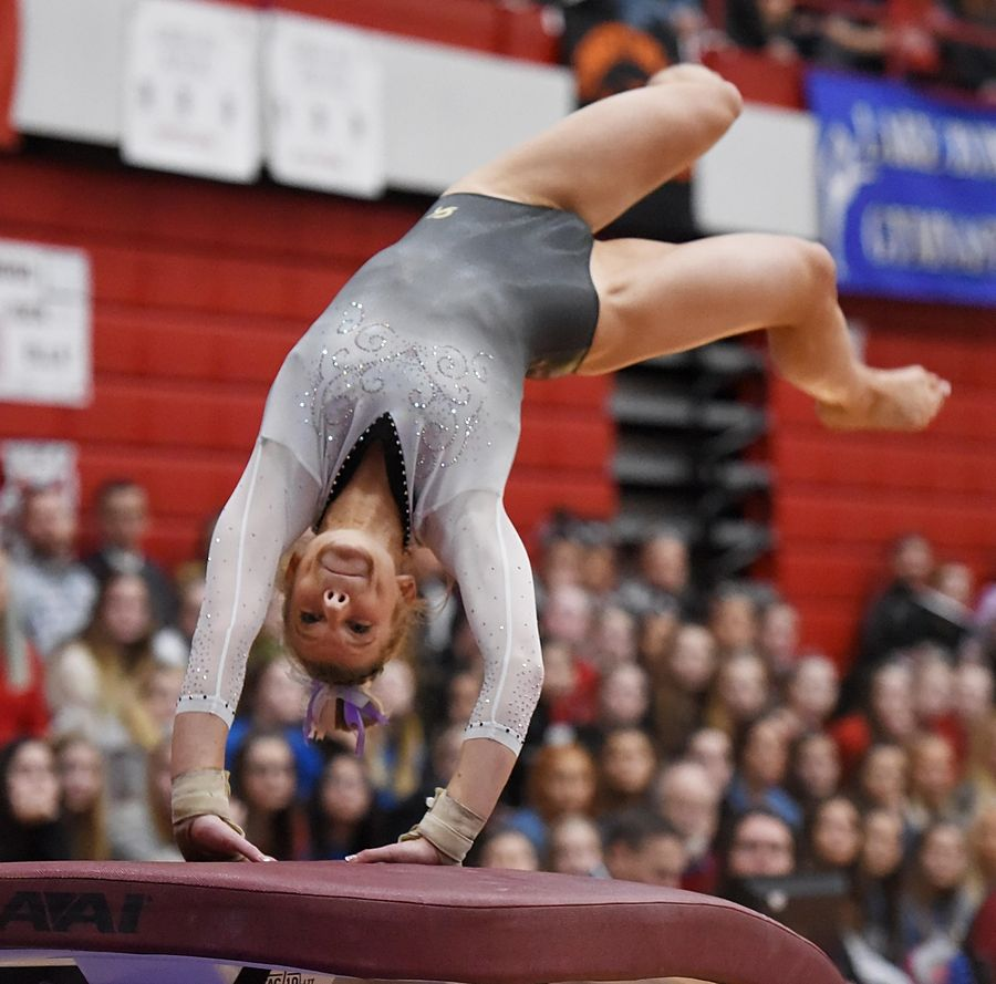 Carmel's Lyndsey Basara performs on vault at the state girls gymnastics championships at Palatine High School on Saturday.