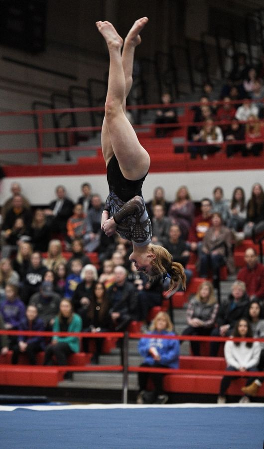 Lake Zurich's Kayla Bailey performs on floor exercise at the state girls gymnastics championships at Palatine High School on Saturday.