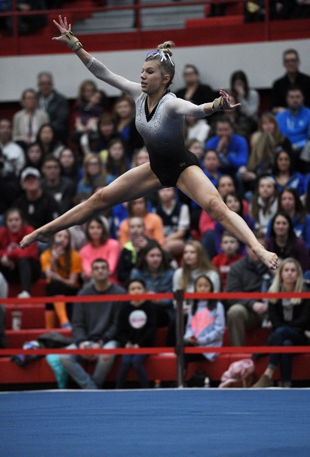 Carmel's Lyndsey Basara performs on floor exercise at the state girls gymnastics championships at Palatine High School on Saturday.