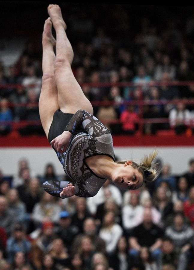 Lake Zurich's Kelsey Rothas performs on floor exercise at the state girls gymnastics championships at Palatine High School on Saturday.