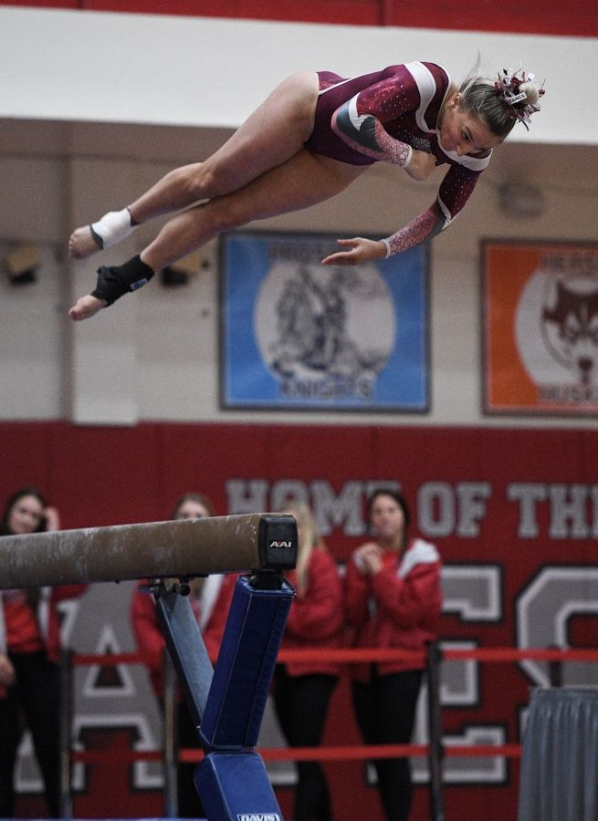 Mundelein's Amanda Muench performs on balance beam at the state girls gymnastics championships at Palatine High School on Saturday.