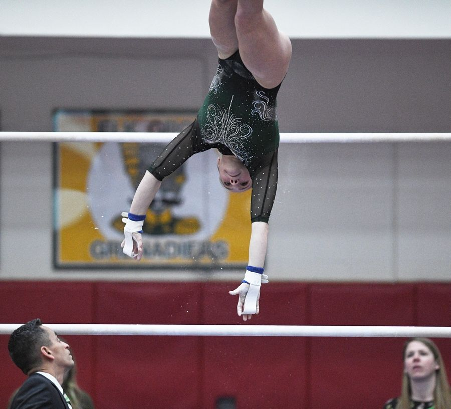Glenbard West's Anna Diab on uneven parallel bars at the state girls gymnastics championships at Palatine High School on Saturday.