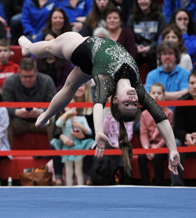Glenbard West's Anna Diab performs on floor exercise at the state girls gymnastics championships at Palatine High School on Saturday.