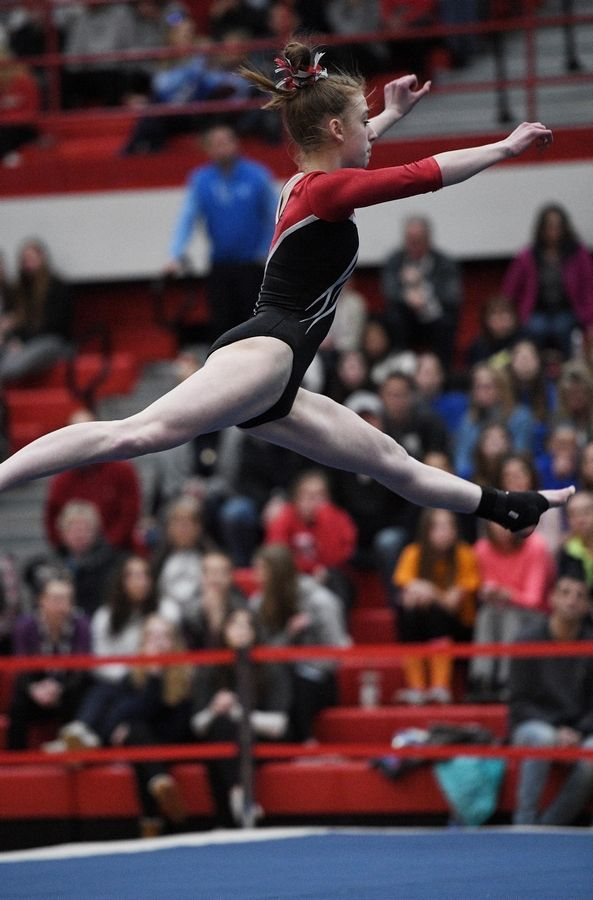 Glenbard East's Rebecca Honig performs on floor exercise at the state girls gymnastics championships at Palatine High School on Saturday.