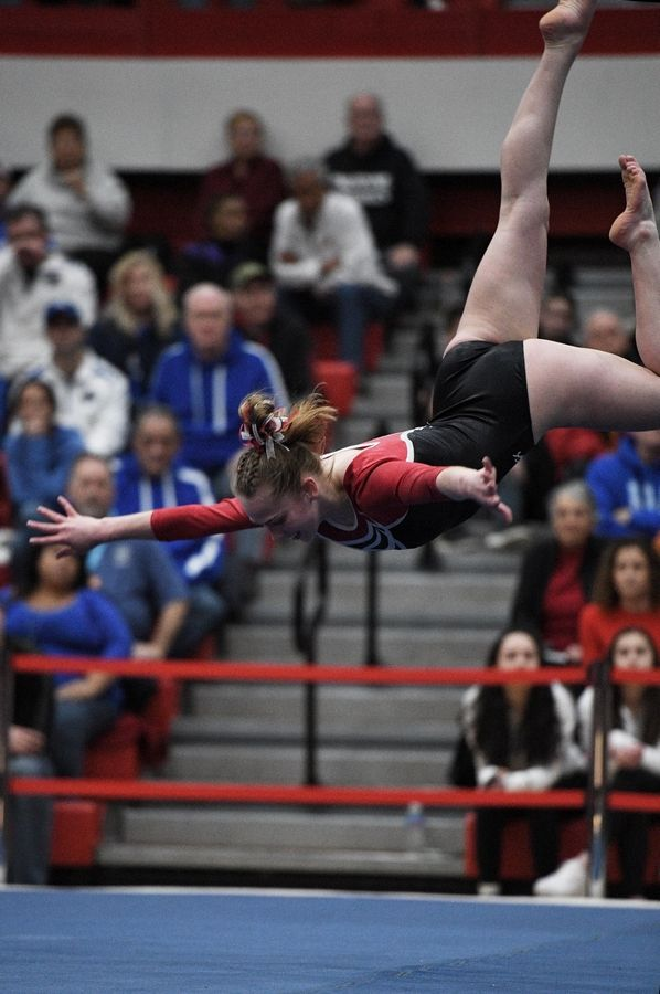 Glenbard East's Kelsey Donovan performs on floor exercise at the state girls gymnastics championships at Palatine High School on Saturday.