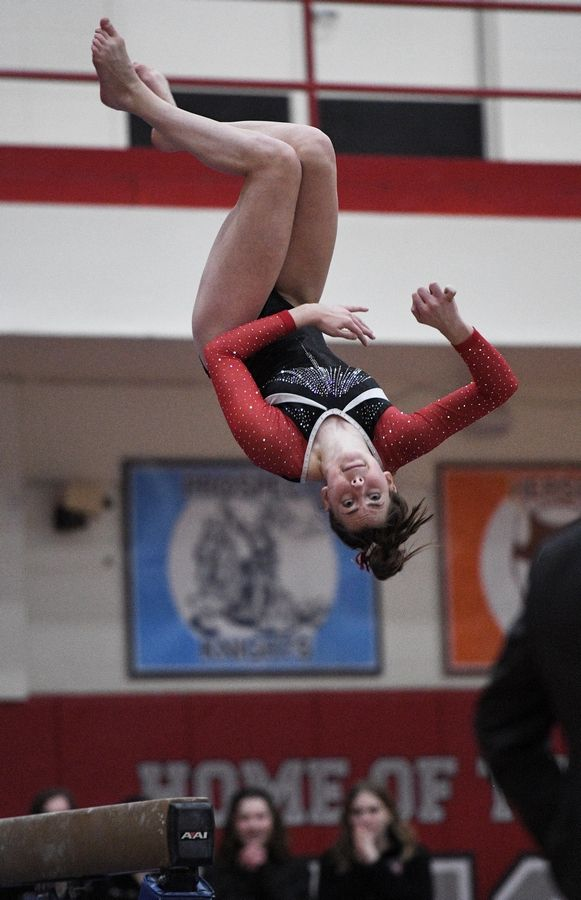 Barrington's Alana Riemenschneider performs on balance beam at the state girls gymnastics championships at Palatine High School on Saturday.