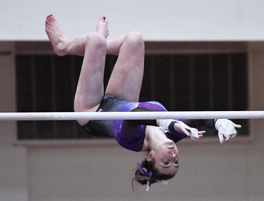 Rolling Meadows' Nicole Kane on uneven parallel bars at the state girls gymnastics championships at Palatine High School on Saturday.