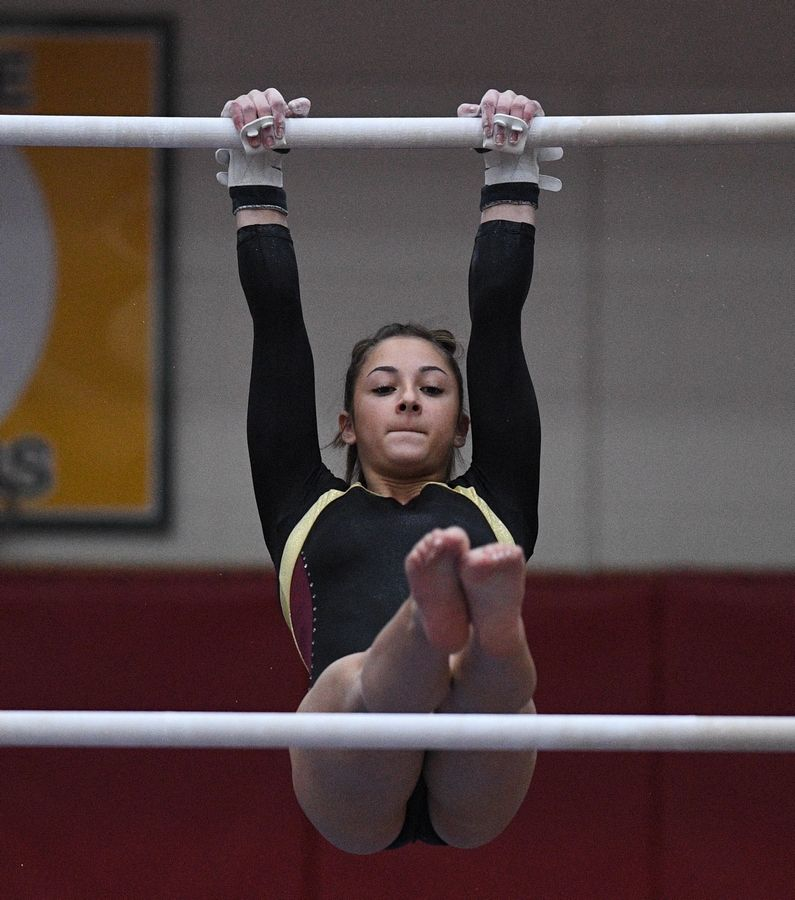 Schaumburg's Alexis Rothmeyer on uneven parallel bars at the state girls gymnastics championships at Palatine High School on Saturday.