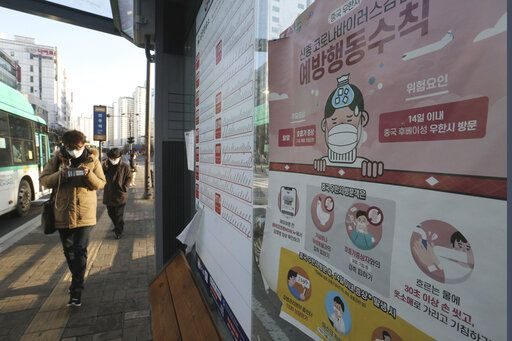 "A poster detailing precautions to take against the coronavirus is seen at a bus station in Goyang, South Korea, Sunday, Feb. 23, 2020. South Korea's president has put the country on its highest alert for infectious diseases and says officials should take ""unprecedented, powerful"" steps to fight a viral outbreak. The signs read ""Precautions against the coronavirus."""