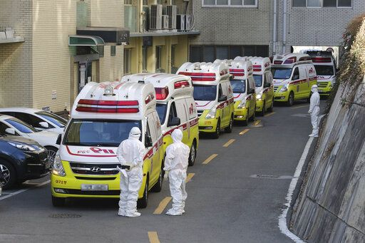 "Ambulances carrying patients infected with the novel coronavirus arrive at a hospital in Daegu, South Korea, Sunday, Feb. 23, 2020. South Korea's president has put the country on its highest alert for infectious diseases and says officials should take ""unprecedented, powerful"" steps to fight a viral outbreak.(Lim Hwa-young/Yonhap via AP)"