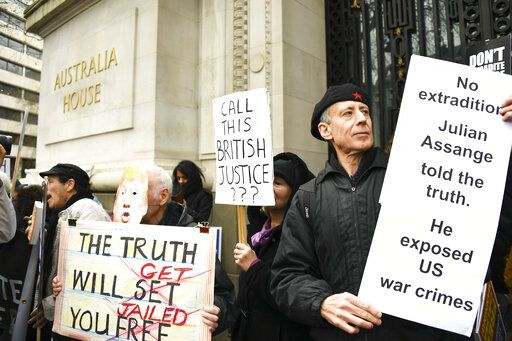 Demonstrators gather outside Australia House to protest against the extradition of Wikileaks founder Julian Assange, in London, Saturday, Feb. 22, 2020. Assange is fighting extradition to the United States on spying charges.