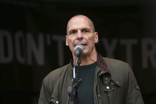 Former Greek economist politician Yanis Varoufakis speaks to crowds gathered at Parliament Square in London, protesting against the imprisonment and extradition of Wikileaks founder Julian Assange  extradition, Saturday Feb. 22, 2020.  (Isabel Infantes/PA via AP)