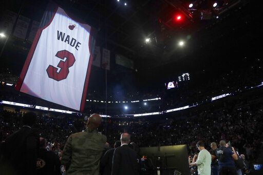 Former Miami Heat guard Dwyane Wade's jersey is hoisted to the rafters during a jersey retirement ceremony at halftime of an NBA basketball game between the Heat and the Cleveland Cavaliers, Saturday, Feb. 22, 2020, in Miami.