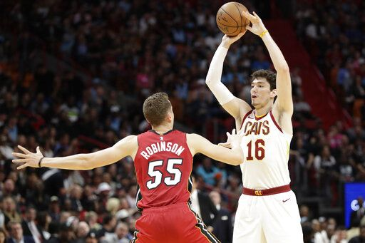 Cleveland Cavaliers forward Cedi Osman (16) passes past Miami Heat guard Duncan Robinson (55) during the first half of an NBA basketball game, Saturday, Feb. 22, 2020, in Miami.