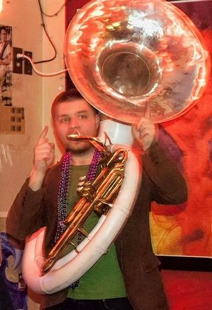 Chris Michelotti of Des Plaines, a founding member of the Big Style Brass Band, plays Sousaphone in the band.