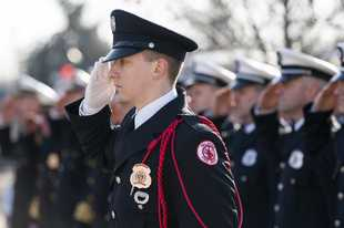 Palatine firefighter/paramedic Jason Grenier salutes during a memorial service Sunday honoring the sacrifice of three volunteer firefighters who died in the line of duty while battling a blaze Feb. 23, 1973 in downtown Palatine.
