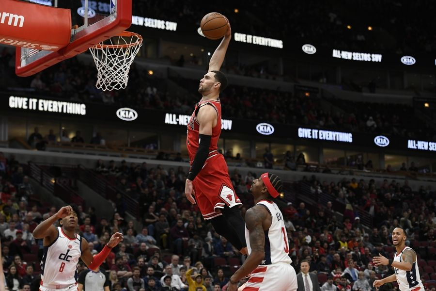 Chicago Bulls' Zach La Vine (8) dunks during the second half of an NBA basketball game against the Washington Wizards Sunday, Feb. 23, 2020, in Chicago. Chicago won 126-117.