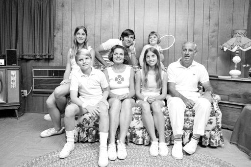 FILE - In this Feb. 13, 1972, file photo, members of the Evert family are shown in their home in Fort Lauderdale, Fla. Front row from left are John, 10, mother Colette, Jeanne, 14, and father James. Back from left are  Chris, Drew, 18 and Clare, 4. Jeanne Evert Dubin, a former world-ranked professional tennis player and a younger sister of 18-time Grand Slam champion Chris Evert, has died. Evert Dubin died Thursday, Feb. 20, 2020, after a 2 1/2-year struggle with ovarian cancer. She was 62.