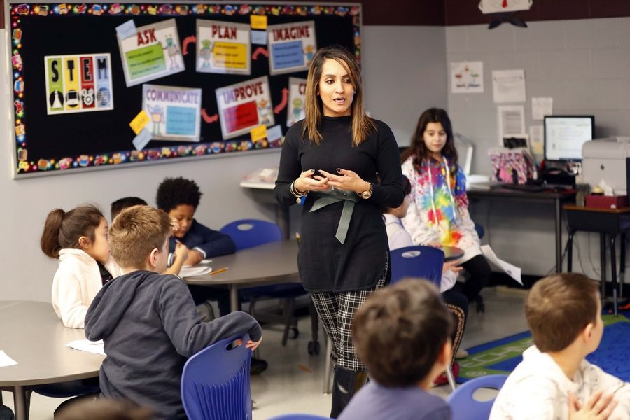 STEM teacher Nicky Hundal, trained through the Project Lead the Way program, leads a class of third-grade students at Glen Hill Primary School in Glendale Heights.