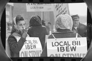 The Daily Herald Archive, Assignment # 3,106, Tom Grieger photo: About 15 members of Local 811 of the International Brotherhood of Electric Workers picketed the north side Arlington Heights offices of Illinois Bell Telephone Company on Wednesday, Feb. 23, 1966. It marked the first day of the strike, which was called after union members refused to ratify an agreement between union officials and management.