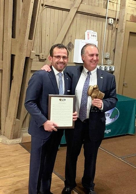 Incoming Hawthorn Mayor Dominick DiMaggio, right, presents a proclamation of appreciation to outgoing Mayor Joseph Mancino during the latter's final meeting Monday night. Mancino, the village's top elected official for 11 years, stepped down Monday and will move to Chicago in early March.