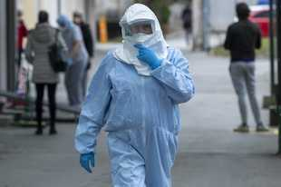 A health worker wears protective suit Tuesday at the infectious disease clinic in Zagreb, Croatia, where the first coronavirus case in Croatia is hospitalized. Croatia confirmed its first case of coronavirus in a man who had been to Milan, the capital of Lombardy, Italy.