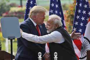U.S. President Donald Trump and Indian Prime Minister Narendra Modi embrace Tuesday after giving a joint statement in New Delhi, India.