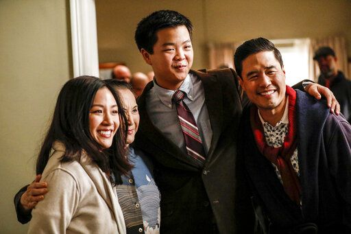 "This image released by ABC shows Constance Wu, from left, Lucille Soong, Hudson Yang and Randall Park in a scene from the series finale of ""Fresh Off the Boat,"" which aired on Friday, Feb. 21. (Raymond Liu/ABC via AP)"