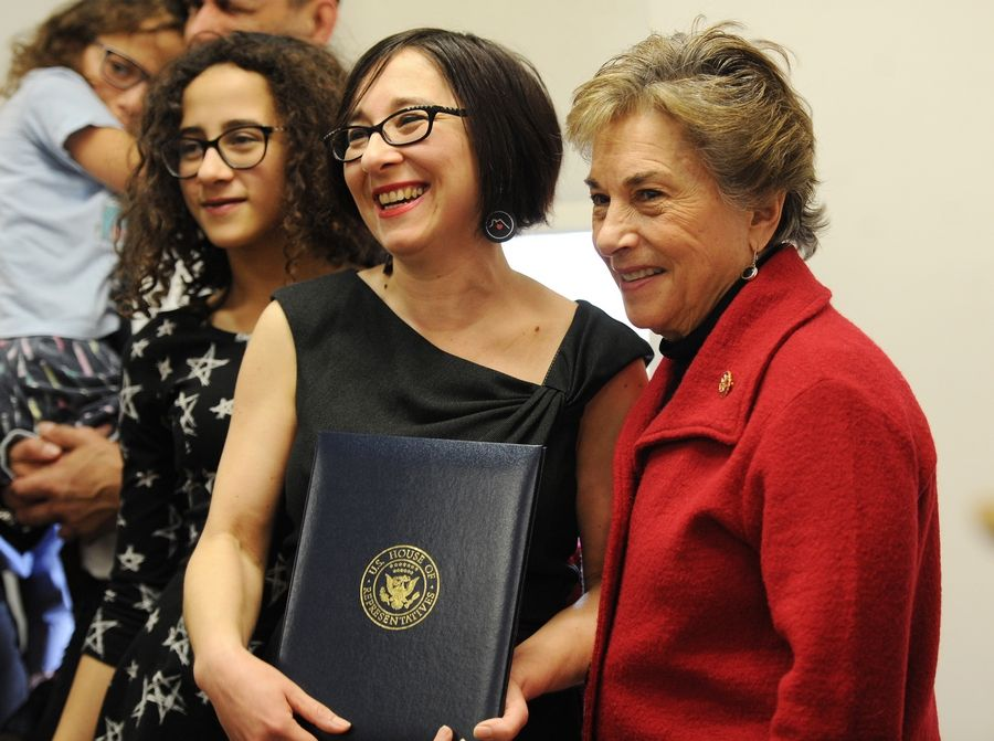 U.S. Rep. Jan Schakowsky, right, presented Arlington Heights librarian Maria Papanastassiou with a document that will be read into the Congressional Record about the I Love My Librarian award Papanastassiou received from the American Library Association. Schakowsky honored Papanastassiou during a brief ceremony at the library Tuesday.