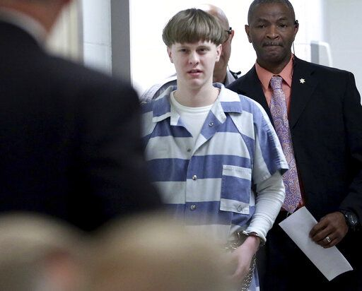FILE - In this Monday, April 10, 2017 file photo, Dylann Roof arrives to a courtroom at the Charleston County Judicial Center in Charleston, S.C., to enter his guilty plea on murder charges. The white supremacist church shooter staged a hunger strike in February 2020 while on federal death row, alleging in letters to The Associated Press that he's been 'œtargeted by staff,'� 'œverbally harassed and abused without cause'� and 'œtreated disproportionately harsh.'� (Grace Beahm/The Post And Courier via AP, Pool, File)