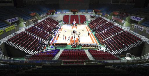 The stadium's seats are empty during the Korean Basketball League between Incheon Electroland Elephants and Anyang KGC clubs in Incheon, South Korea, Wednesday, Feb. 26, 2020. The basketball game held without spectators as a precaution against the COVID-19. (Yun Tai-hyun/Yonhap via AP)